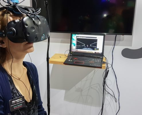 Denise trying the VR Village contributor 'Neurable' EEG VR headset and game